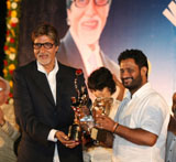 Resul Pukootty is ecstatic as he hugs Amitabh Bachchan who later gave him an award for his contribution to sound industry on behalf of Western India Motion Pictures & TV sound engineers association in Mumbai.