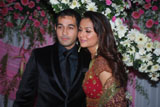 Amrita Arora hugs Shakeel Ladak as she poses after her wedding at Olive restaurant in Mumbai.