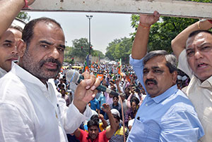 Bjp workers demonstration demands apology from kejriwal on for Farcical antonym