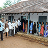 Voters standing in queue to cast their votes at a polling booth