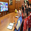 PM Modi interacting with the children at the launch of the Reliance Foundation
